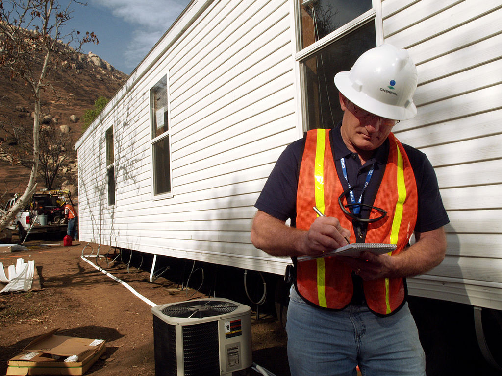 Home Inspector inspecting mobile home